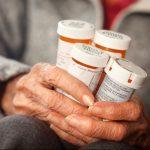 elderly-womans-hands-holding-prescription-medication-bottles-e1562590901408-150×150