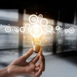 hand-holding-light-bulb-and-cog-inside-representing-idea-and-imagination.-e1571848324442-150×150