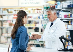 male-pharmacist-talking-with-a-patient-about-a-medication-in-a-community-pharmacy