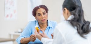 female-doctor-explaining-a-prescription-medication-to-a-female-patient