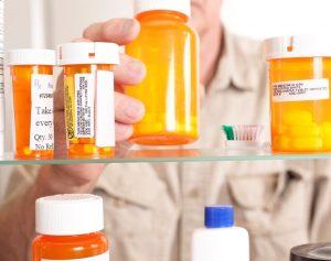 prescription-medication-bottles-in-a-medicine-cabinet