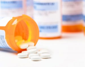 prescription-medication-bottles-and-white-tablets