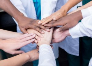 group-of-unified-healthcare-professionals-hands-together-in-a-circle