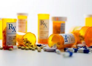 prescription-pill-bottles-with-spilled-pills